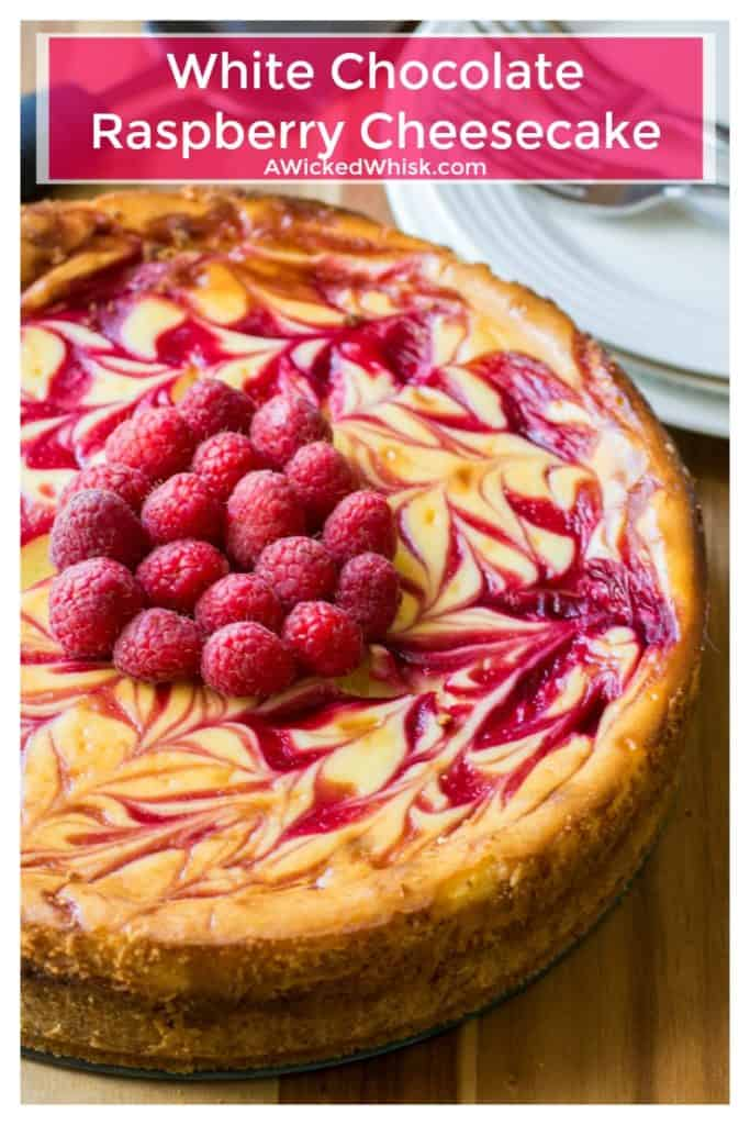 White Chocolate Raspberry Cheesecake is the perfect twist on your favorite cheesecake dessert. Creamy white chocolate and tart raspberry sauce help make thisWhite Chocolate Raspberry Cheesecake the best cheesecake you will ever have! | A Wicked Whisk | https://www.awickedwhisk.com #cheesecake #cheesecakeeast #whitechocolateraspberrycheesecake #raspberrycheesecake #whitechocolatecheesecake #dessert #summerfood #fourthofjulydessert #fourthofjulyparty #easterdessert #mothersdaydessert
