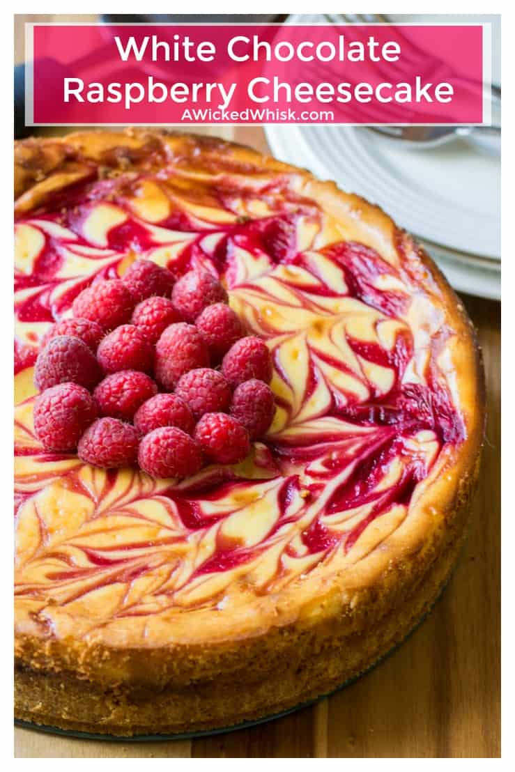 White Chocolate Raspberry Cheesecake is the perfect twist on your favorite cheesecake dessert. Creamy white chocolate and tart raspberry sauce help make this White Chocolate Raspberry Cheesecake the best cheesecake you will ever have! | A Wicked Whisk | https://www.awickedwhisk.com #cheesecake #cheesecakeeast #whitechocolateraspberrycheesecake #raspberrycheesecake #whitechocolatecheesecake #dessert #summerfood #fourthofjulydessert #fourthofjulyparty #easterdessert #mothersdaydessert
