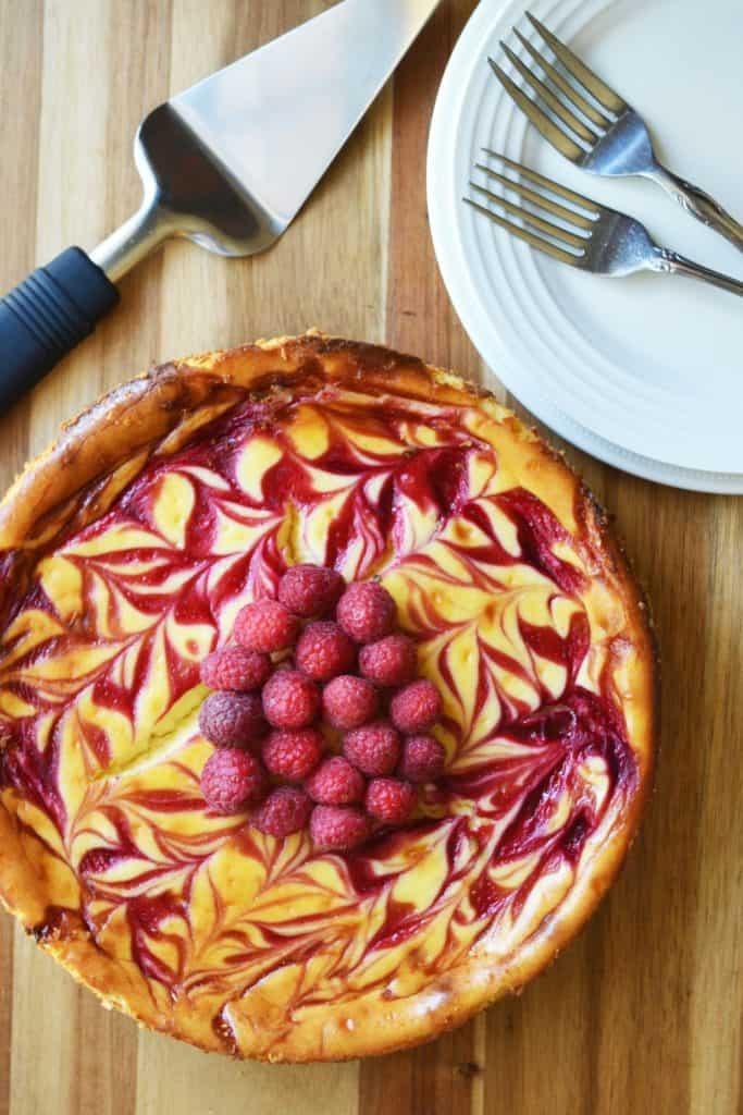 White Chocolate Raspberry Cheesecake on a platter