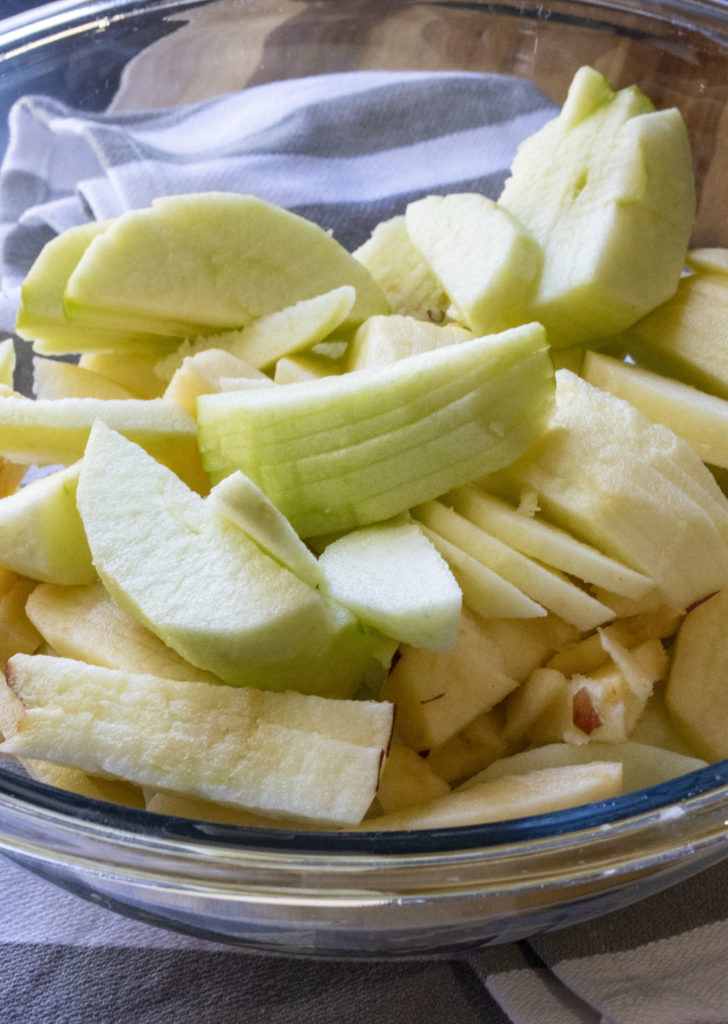 sliced apples in a mixing bowl