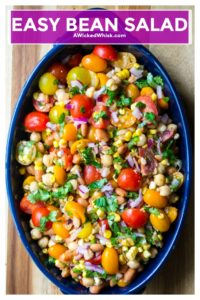 Easy Bean Salad is tangy, tart and the only bean salad you will need for your next social get together. Made with pinto beans, garbanzo beans, fresh vegetables and lime juice, this Easy Bean Salad is the ultimate in quick, easy, delicious side dishes. | A Wicked Whisk | https://www.awickedwhisk.com #beansalad #easybeansalad #beansaladrecipe #summersalad #bbqsidedish #partysidedish #partyfood #healthysidedish #healthychoices #healthysalad