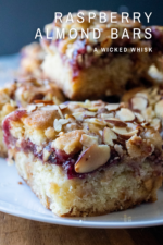Raspberry Almond Crumble Bars are sweet, tart and packed with raspberry fruit flavor! These easy raspberry layers bars are made with a buttery crust, white chocolate chips, thick raspberry filling and a crunchy layer of almond crumble. The perfect summer dessert everyone will love! #raspberrybars #raspberryalmondbars #raspberrycrumblebars #raspberryalmondbarsrecipe #raspberryalmondbarswhitechocolate