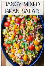 Tangy Mixed Bean Salad is tangy, tart and refreshing, this is the only bean salad you will need for your next social get together.  Made with pinto beans, garbanzo beans, fresh vegetables and lime juice, this colorful salad is the ultimate in delicious easy side dishes. #beansalad #mixedbeansalad #garbanzobeansalad #summerbeansalad #beansaladhealthy