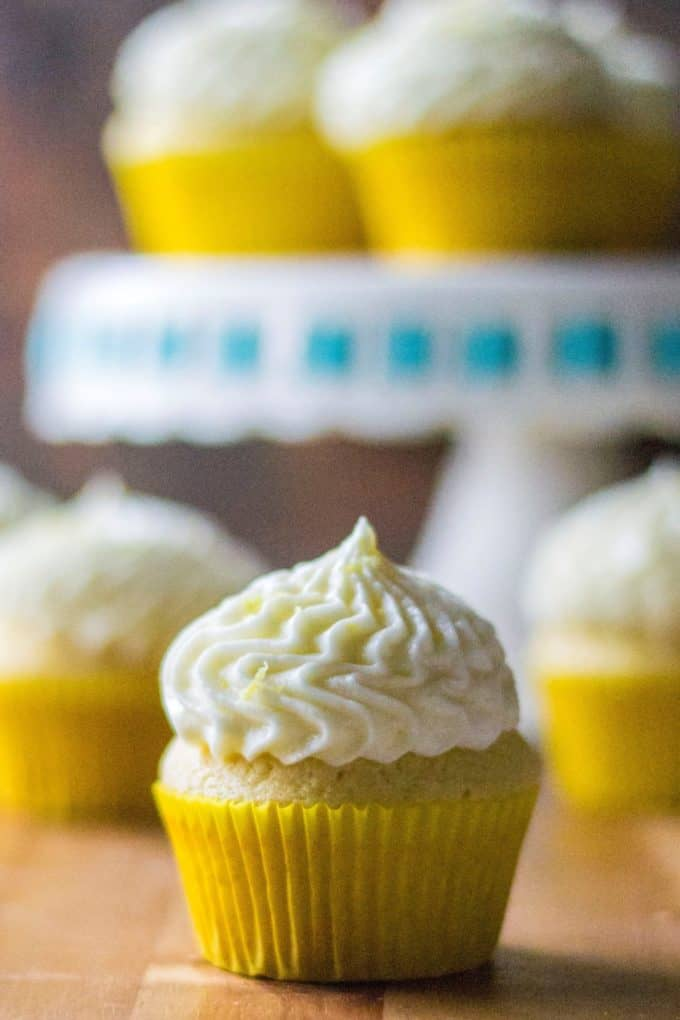 Lemon Cupcakes with Lemon Buttercream Frosting is the ultimate way to kick up boring ol' desserts.  Made with fresh lemon juice and tons of flavor, these homemade Lemon Cupcakes with Lemon Buttercream Frosting are zingy, refreshing and the best super moist lemon cupcakes you will ever eat!