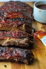Sticky Barbeque Oven Baked Ribs are tender oven baked ribs smothered in a spicy sweet Asian inspired sauce that will have you licking your fingers and reaching for more. Baked in the oven and slathered in a homemade barbeque sauce, these Sticky Barbeque Oven Baked Ribs are the perfect no-fuss way to enjoy baked ribs.