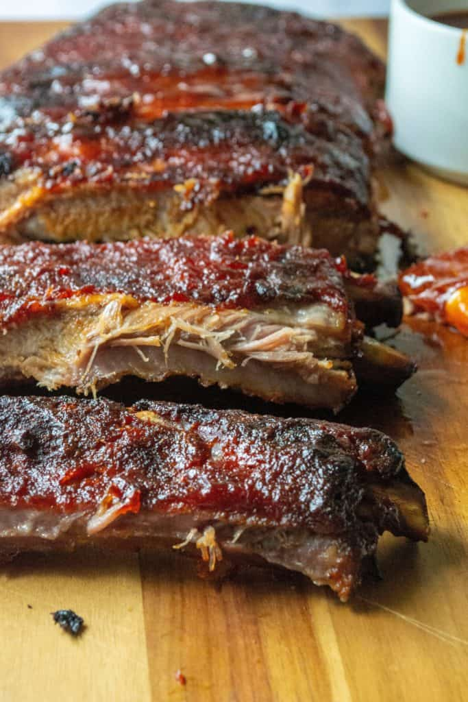 oven baked ribs on a cutting board