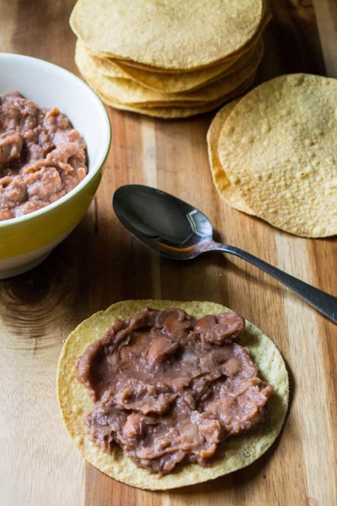 Chicken Tinga Tostadas refried beans