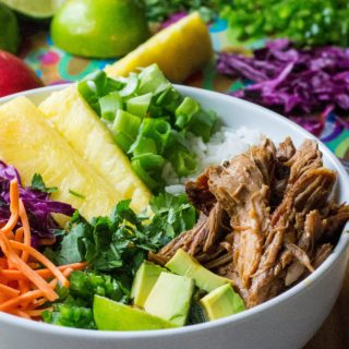 Hawaiian Pork Rice Bowl is sweet spicy slow cooker pork served up over rice, cabbage and pineapple jalapeno salsa in the perfect pork rice bowl. Delicious easy comfort food!