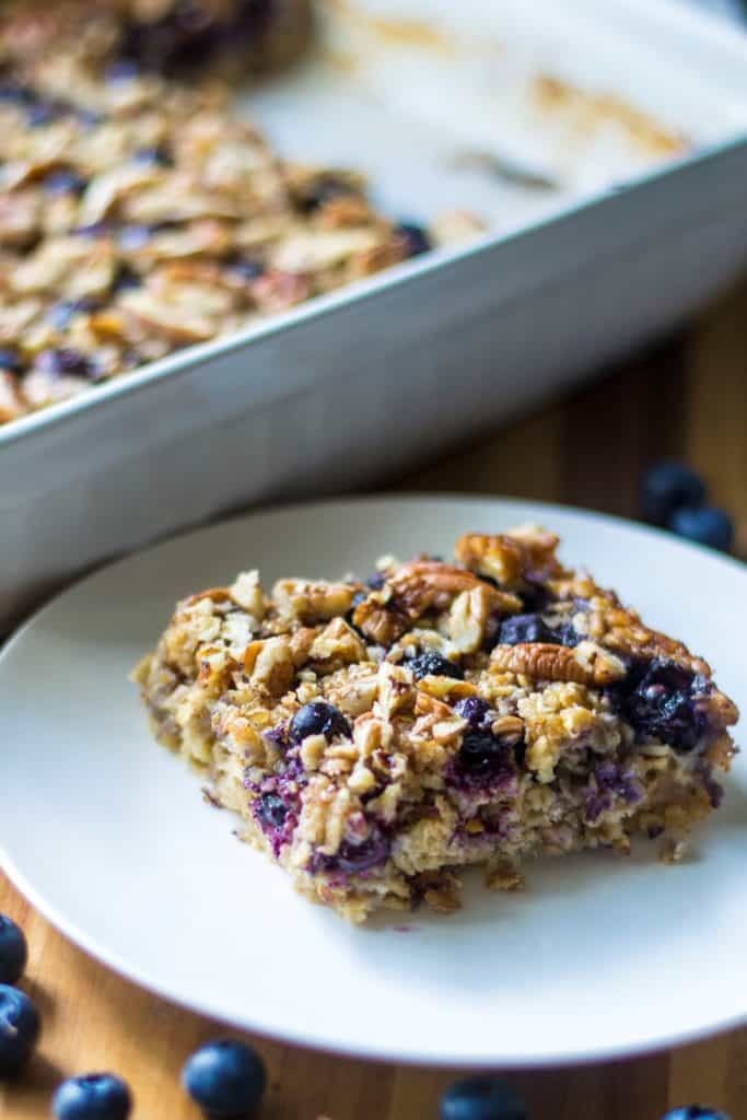 Baked Blueberry Pecan Oatmeal is the BEST Baked Oatmeal recipe and the perfect make it ahead breakfast idea. Ideal to serve for brunch and a perfect back to school breakfast idea, this Baked Blueberry Pecan Oatmeal is a heart-healthy breakfast choice and the leftovers taste just as good the next day! Perfect!