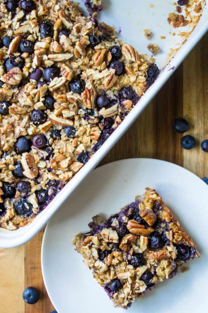 Baked Blueberry Pecan Oatmeal is the BEST Baked Oatmeal recipe and the perfect make it ahead breakfast idea. Ideal to serve for brunch and a perfect back to school breakfast idea, this Baked Blueberry Pecan Oatmeal is a heart-healthy breakfast choice and the leftovers taste just as good the next day!