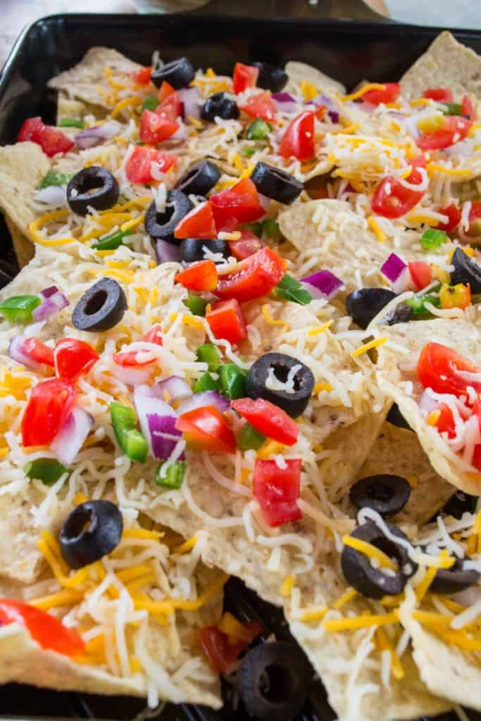 Take your tailgating fun to the next level with these Grilled Fully Loaded Veggie Nachos. Made with MorningStar Farms® Meat Lovers Burgers, these Grilled Fully Loaded Veggie Nachos are loaded up with your favorite toppings and are the perfect meatless vegan snack.