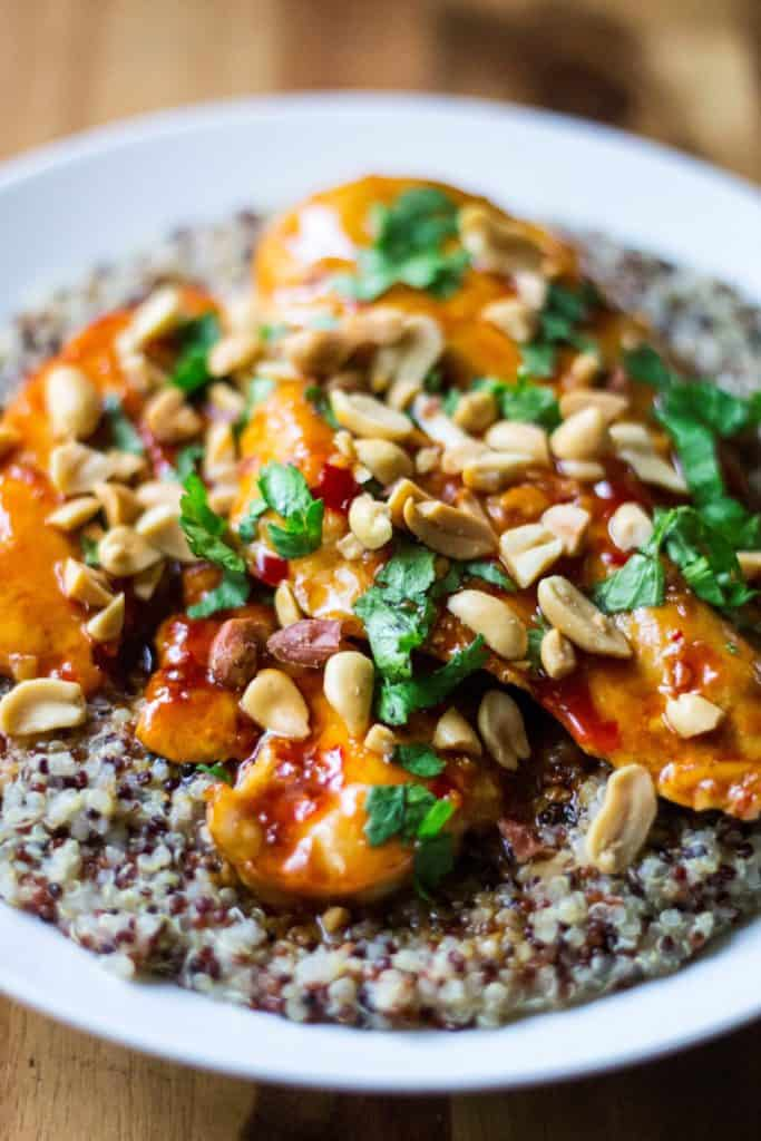 Spicy Thai Chicken with Coconut Lime Quinoa is tender, moist chicken simmered in a spicy Thai sauce and paired with creamy coconut lime quinoa. Sweet, spicy and sticky, thisSpicy Thai Chicken with Coconut Lime Quinoa is sure to be your new favorite 30 minute meal!