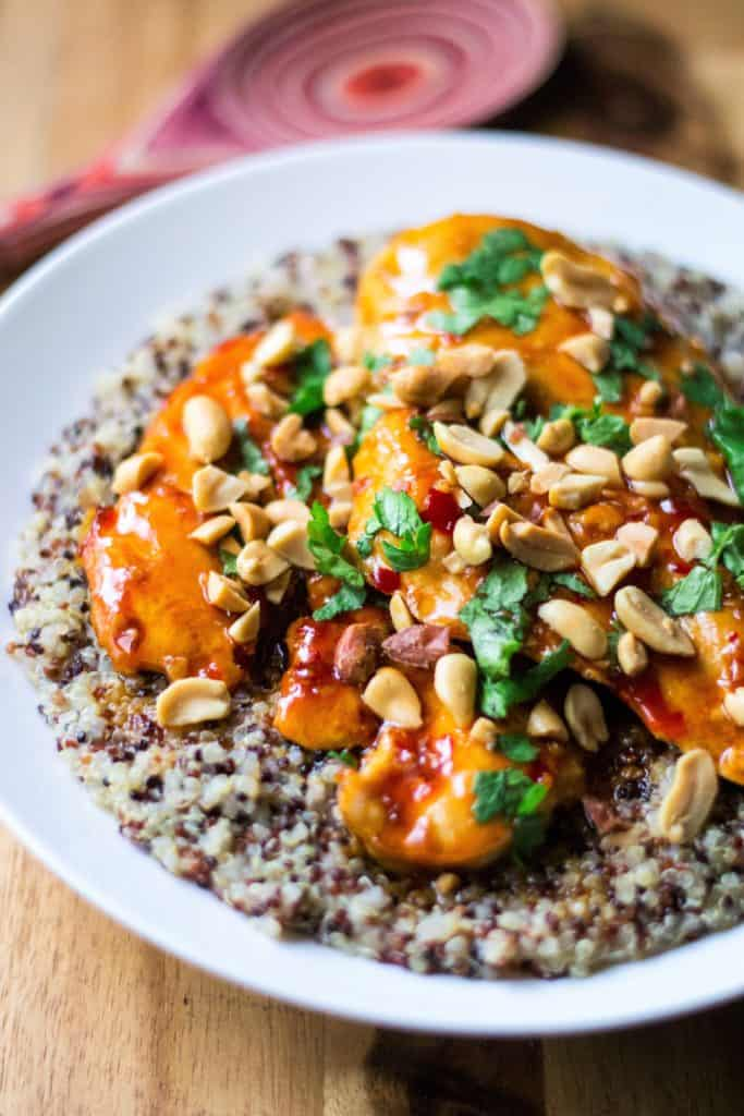 Spicy Thai Chicken with Coconut Lime Quinoa is tender, moist chicken simmered in a spicy Thai sauce and paired with creamy coconut lime quinoa. Sweet, spicy and sticky, this Spicy Thai Chicken with Coconut Lime Quinoa is sure to be your new favorite 30 minute meal!