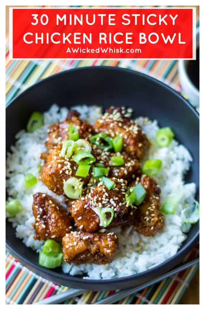 Sticky Chicken Rice Bowl is the perfect combination of tender rice and baked chicken bites covered in a thick sticky sauce and it is sure to be your new favorite sweet and spicy chicken recipe. A quick and easy Asian chicken recipe, this Sticky Chicken Rice Bowl is ready to serve up in just 30 minutes! #stickychicken #30minutemeal #easyasianchickenrecipe #easychickendinner #sweetandspicychicken #bakedasianchicken #stickychickenricebowl #chickenricebowl #spicychicken #stickychickenrecipe #chicken