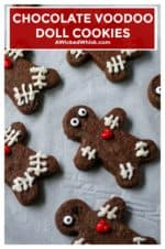 These Chocolate Voodoo Doll Cookies are made with a chocolate sugar cookie dough and have a dark rich flavor, they hold their shape perfectly and are the best chocolate cut out cookies to celebrate the Halloween season. | A Wicked Whisk #voodoodollcookies #voodoodollcookieshalloweenparty #voodoodollcookiesrecipe #chocolatevoodoodollcookies #voodoodollfood #halloweencookies #halloweencookieseasy #halloweencookiesdecorated #chocolatecutoutcookies