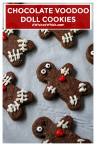These Chocolate Voodoo Doll Cookies are made with a chocolate sugar cookie dough and have a dark rich flavor, they hold their shape perfectly and are the best chocolate cut out cookies to celebrate the Halloween season.| A Wicked Whisk #voodoodollcookies #voodoodollcookieshalloweenparty #voodoodollcookiesrecipe #chocolatevoodoodollcookies #voodoodollfood #halloweencookies #halloweencookieseasy #halloweencookiesdecorated #chocolatecutoutcookies