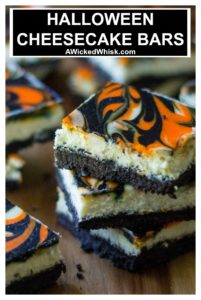 Halloween Cheesecake Bars are the perfect Halloween dessert to show off your spooky spirit. Creamy cheesecake with a cookie crust, these orange and black Halloween Cheesecake Bars are the perfect easy dessert to celebrate Halloween. | https://www.awickedwhisk.com | #halloweendessert #easyhalloweendessert #halloweencheesecake #halloweencheesecakebars #orangeblackcheesecake #orangeandblackdessert #easycheesecakebars #orangeandblackfood #halloweenfood #cheesecakebars