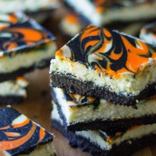 Halloween CheesecakeBars are the perfect Halloween dessert to show off your spooky spirit. Creamy cheesecake with a cookie crust, these orange and blackHalloween CheesecakeBars are the perfect easy dessert to celebrate Halloween.