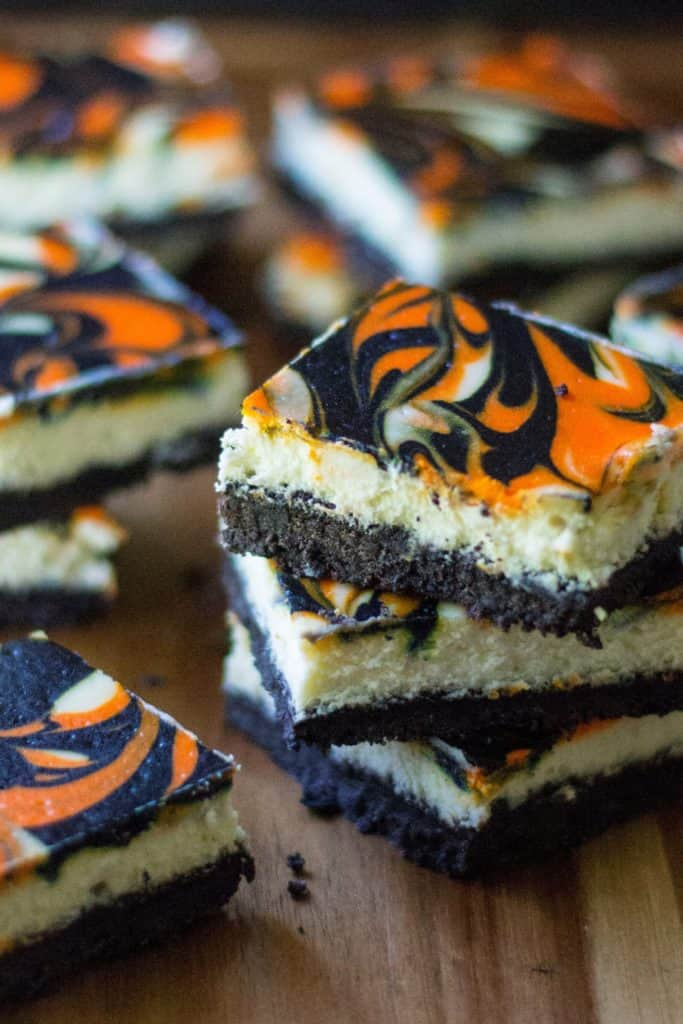 Halloween Cheesecake Bars are the perfect Halloween dessert to show off your spooky spirit. Creamy cheesecake with a cookie crust, these orange and black Halloween Cheesecake Bars are the perfect easy dessert to celebrate Halloween.
