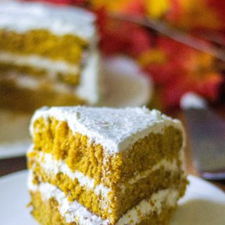 Pumpkin Spice Cake with Cream Cheese Frosting is the most perfect moist pumpkin cake recipe you will ever make and an easy pumpkin dessert to serve up anytime of the year!