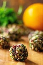 Orange Cranberry Pecan Goat Cheese Truffles only take 15 minutes to make and are the perfect easy holiday appetizer.  Made with cranberries, pecans, rosemary and fresh orange juice, these festive mini cheese balls are the hit of every party!