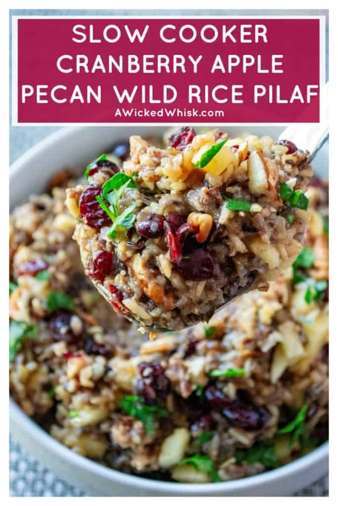 Slow Cooker Cranberry Apple Pecan Wild Rice Pilaf is wild rice slow cooked in apple cider and chicken stock then topped with tart cranberries, sweet apples and crunchy pecans to serve up the perfect slow cooker holiday side dish. #wildricepilaf #slowcookersidedish #holidaysidedish #thanksgivingsidedish #thanksgivingslowcookersidedish #cranberryapplepecanwildrice #christmasslowcookersidedish #cranberrywildrice