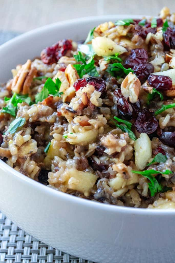 Slow Cooker Cranberry Apple Pecan Wild Rice Pilaf in a white bowl