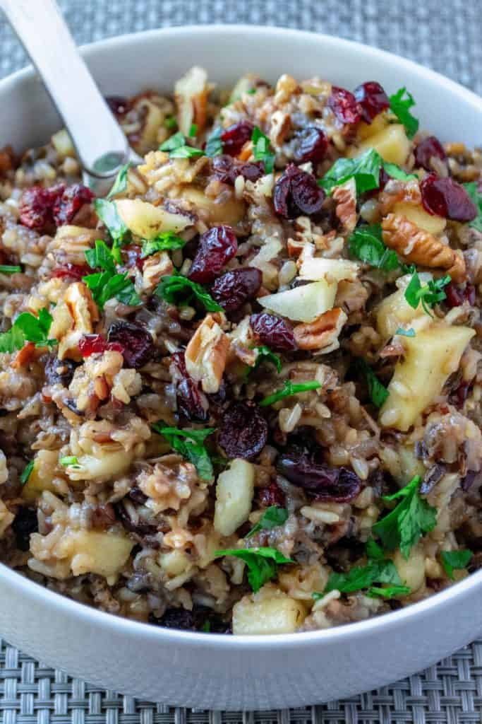 Slow Cooker Cranberry Apple Pecan Wild Rice Pilaf on a spoon
