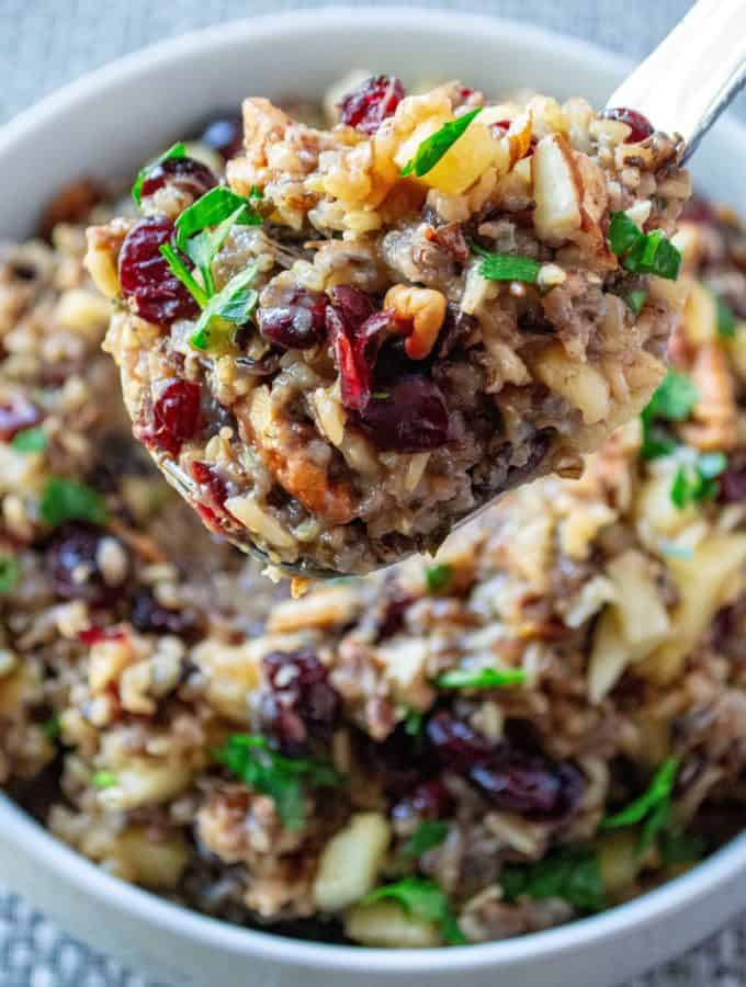 Slow Cooker Cranberry Apple Pecan Wild Rice Pilaf is wild rice slow cooked in apple cider and chicken stock then topped with tart cranberries, sweet apples and crunchy pecans to serve up the perfect slow cooker holiday side dish.