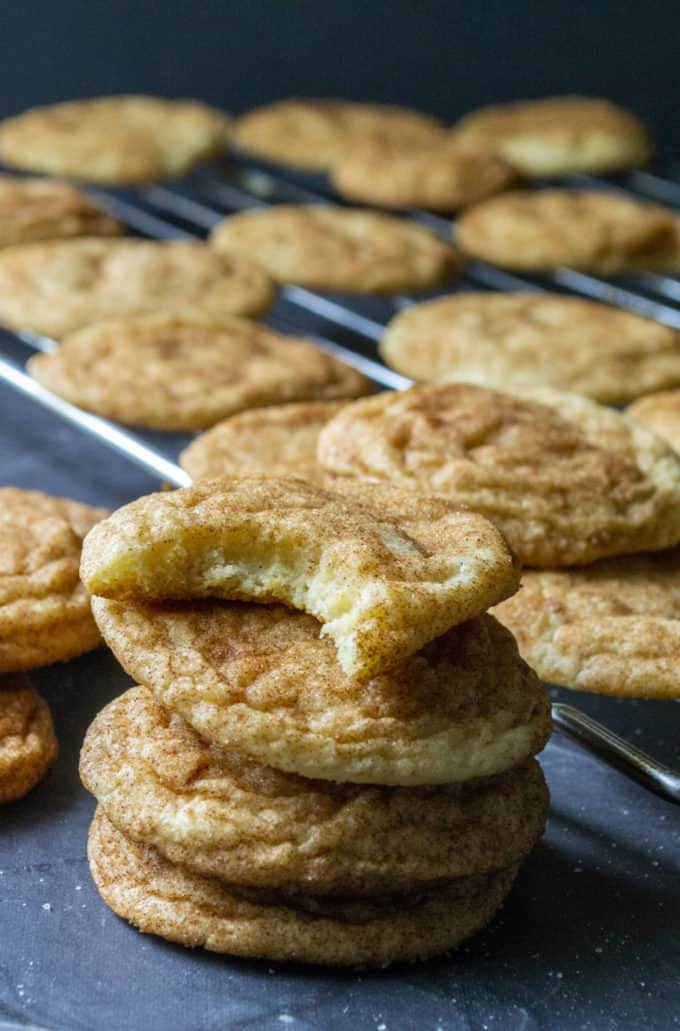 stacked snickerdoodles with bite taken out