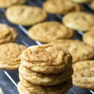 chewy snickerdoodle cookies stacked up on rack