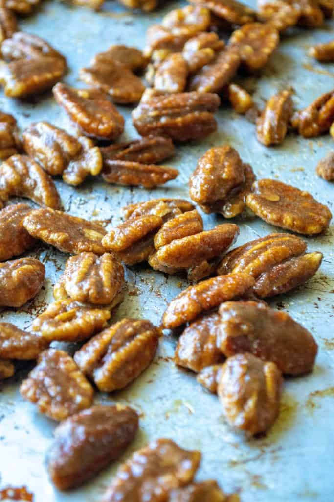 Cinnamon Sugar Candied Pecans on a pan