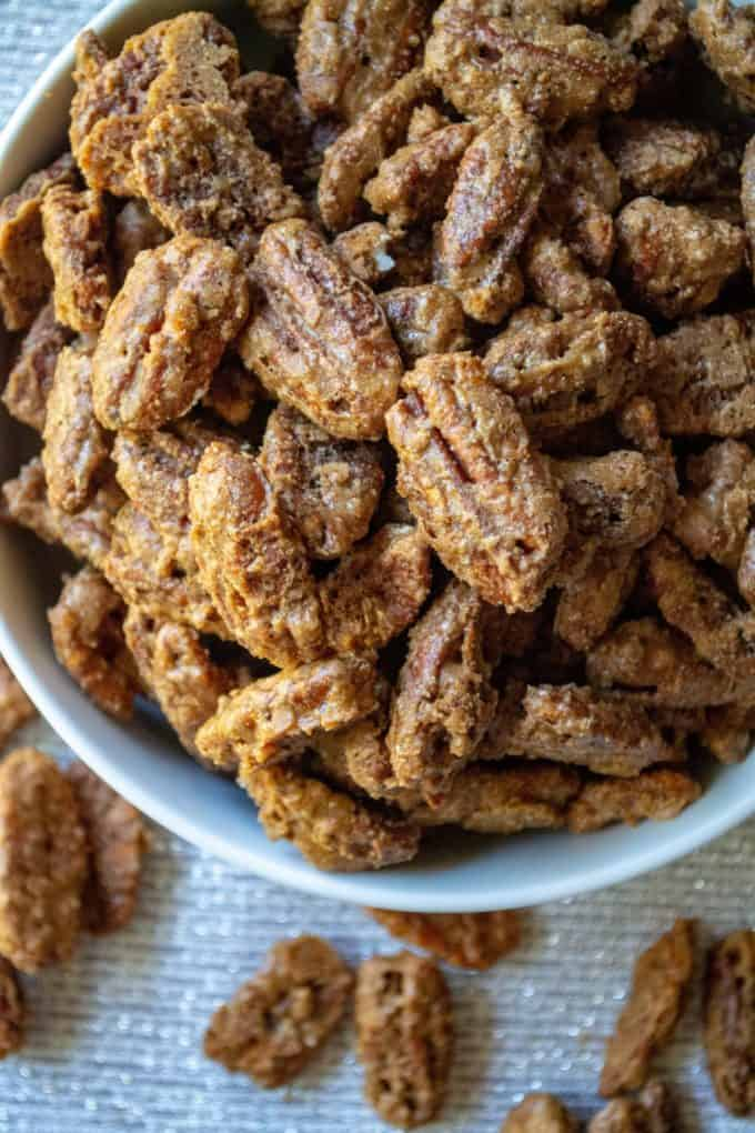 Cinnamon Sugar Candied Pecans are the perfect easy snack for out of hand munching, as a crunchy salad topping and everyones favorite sweet snacks for holiday gift giving.