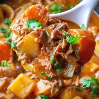Easy Slow Cooker Beef Stew serving spoon