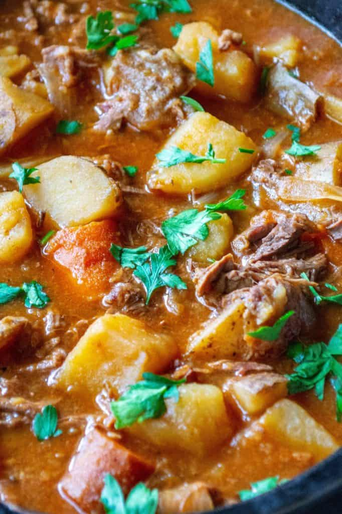 Easy Slow Cooker Beef Stew is made with tender chunks of stew meat, tons of vegetables and a tasty, rich broth making this easy beef stew recipe the perfect slow cooker comfort food.