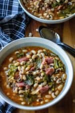 Slow Cooker Black Eyed Peas and Collard Greens is the perfect Southern comfort food to celebrate New Year's Day or ANY day! Made with a leftover ham bone and simmered in a rich tasty broth, theseSlow Cooker Black Eyed Peas and Collard Greens are a delicious addition to your New Year's Day menu.
