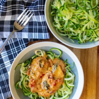 Creamy Tuscan Chicken is tender skillet chicken in a creamy cheese sauce full of sun dried tomatoes, fresh basil and served over a bed of zoodles . Soon to be one of your favorite one pan meals, this Creamy Tuscan Chicken is a low carb keto friendly recipe ready in just 30 minutes!