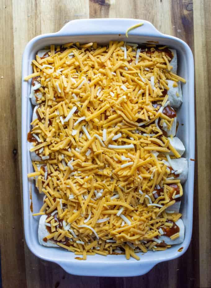 enchiladas covered in sauce and cheese
