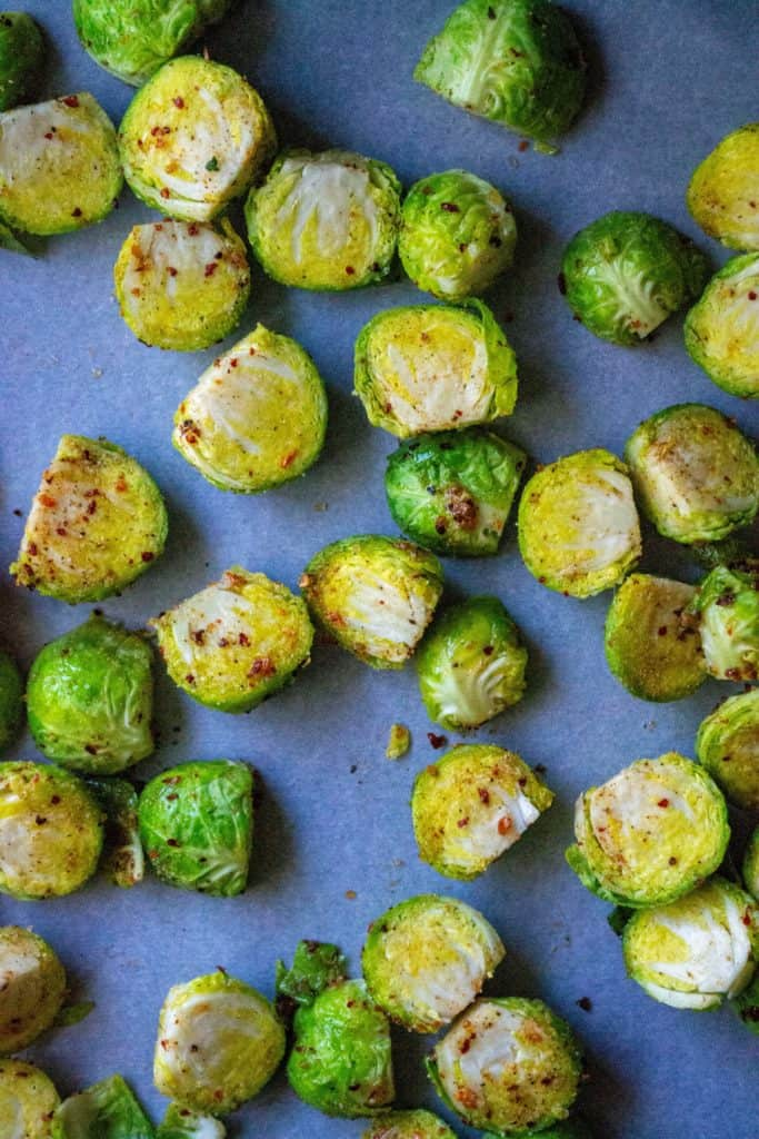 Roasted Brussel Sprouts and Kielbasa brussel sprouts on a pan