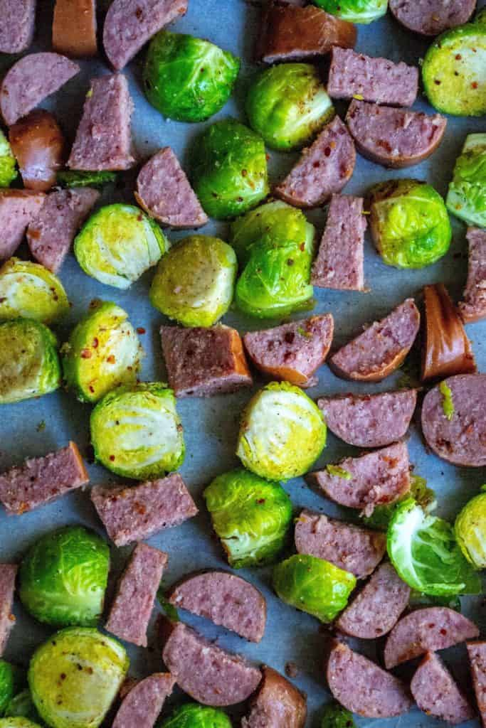 Roasted Brussel Sprouts and Kielbasa is the perfect low-carb sheet pan dinner to serve up in just 20 minutes! Made combining fresh brussel sprouts and smoky kielbasa sausage, thisRoasted Brussel Sprouts and Kielbasa keto friendly meal is hearty and delicious.