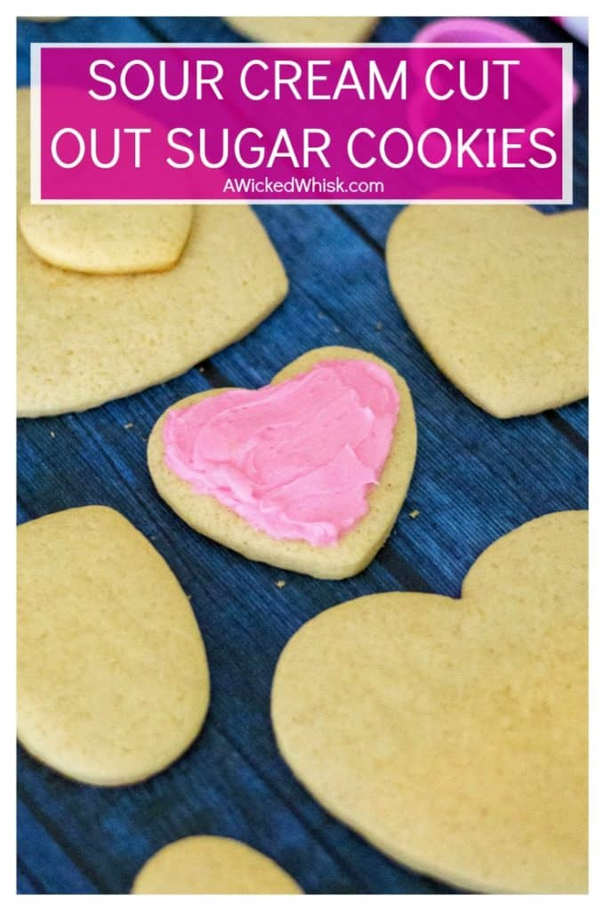 Sour Cream Cut Out Sugar Cookies is an easy soft sugar cookie recipe made with butter, sour cream and a hint of almond.  Topped off with homemade almond buttercream frosting and heart-shaped, these Sour Cream Cut Out Sugar Cookies are reminiscent of Lofthouse cookies and the perfect Valentine's Day cookies to share. #sugarcookies #softsugarcookies #sourcreamcookies #cutoutcookies #valentinesdaycookies #sourcreamcutoutcookies #sourcreamsugarcookies #lofthousecookies
