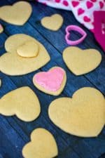 Sour Cream Cut Out Sugar Cookies is an easy soft sugar cookie recipe made with butter, sour cream and a hint of almond.  Topped off with homemade almond buttercream frosting and heart-shaped, these Sour Cream Cut Out Sugar Cookies are reminiscent of Lofthouse cookies and the perfect Valentine's Day cookies to share. | A Wicked Whisk