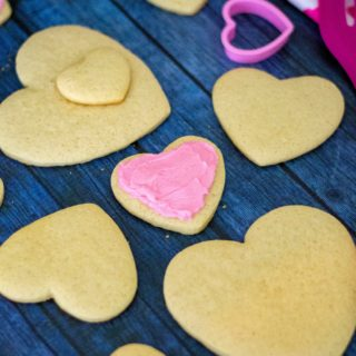 Sour Cream Cut Out Sugar Cookies is an easy soft sugar cookie recipe made with butter, sour cream and a hint of almond. Topped off with homemade almond buttercream frosting and heart-shaped, theseSour Cream Cut Out Sugar Cookies are reminiscent of Lofthouse cookies and the perfect Valentine's Day cookies to share. | A Wicked Whisk