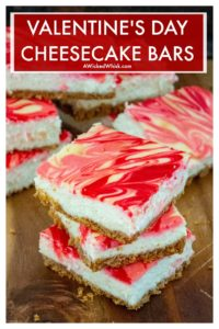 Valentine's Day Cheesecake Bars are creamy pink and red swirled cheesecake bars making them the perfect Valentine's Day dessert. Easy to make and always a favorite at potlucks, parties and bake sales, these Valentine's Day Cheesecake Bars are a sweet way to steal someone's heart. #valentinesdaydessert #valentines #valentinesdayfood #cheesecake #cheesecakebars #valentinesdaycheesecake #valentinesdaycheesecakebars #easyvalentinesdaydessert