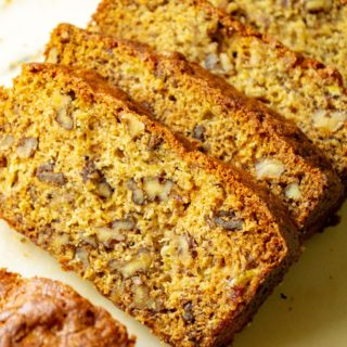 Banana Walnut Bread is the ultimate super moist banana bread made with tons of crunchy walnuts. Made with over-ripe bananas and brown sugar, thisBanana Walnut Bread is the perfect old fashioned homemade banana bread recipe.