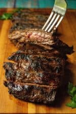 Soy Marinated Broiled Flank Steak is a tender broiled flank steak perfectly seasoned by an overnight flank steak soy sauce marinade. Easily cooked in your oven, thisSoy Marinated Broiled Flank Steak is tender on the inside and perfectly seared on the outside.