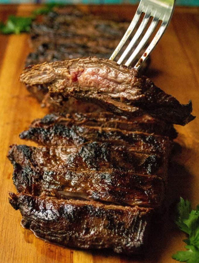 Soy Marinated Broiled Flank Steak is a tender broiled flank steak perfectly seasoned by an overnight flank steak soy sauce marinade. Easily cooked in your oven, this Soy Marinated Broiled Flank Steak is tender on the inside and perfectly seared on the outside.