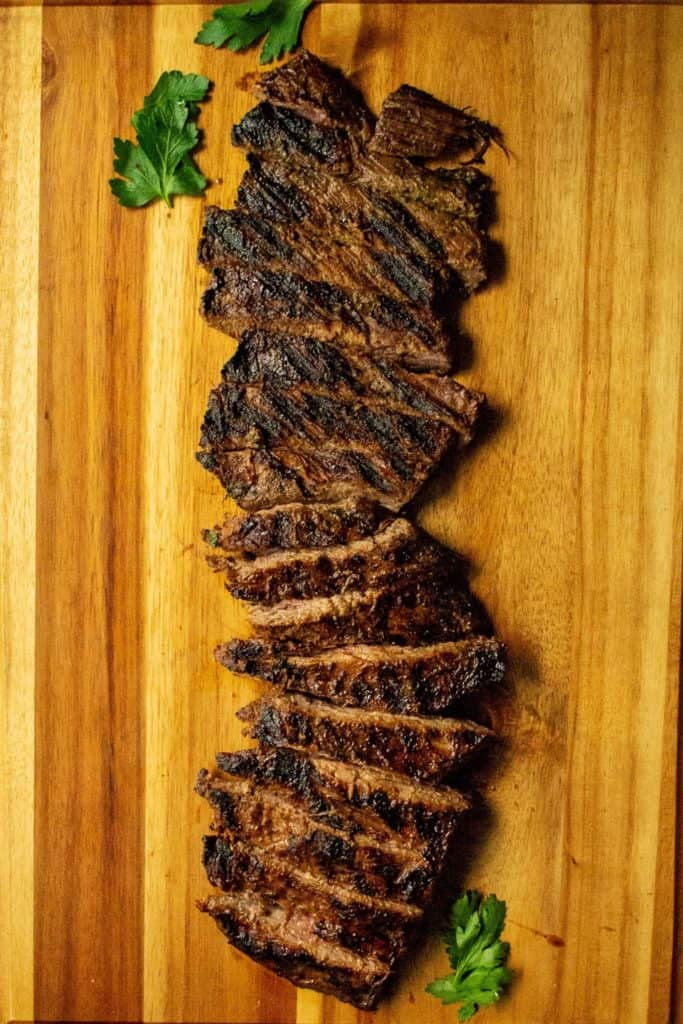 Soy Marinated Broiled Flank Steak seared steak on a cutting board