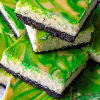St. Patrick's Day Baileys Cheesecake Bars are the perfect green desserts to celebrate St.Patrick's Day all year long. Creamy cheesecake made with Baileys Irish Cream, theseSt. Patrick's Day Baileys Cheesecake Bars are the ultimate swirl cheesecake bars. | A Wicked Whisk