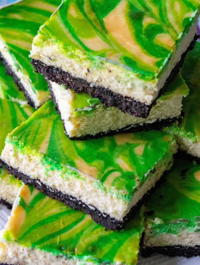 St. Patrick's Day Baileys Cheesecake Bars are the perfect green desserts to celebrate St.Patrick's Day all year long. Creamy cheesecake made with Baileys Irish Cream, these St. Patrick's Day Baileys Cheesecake Bars are the ultimate swirl cheesecake bars. | A Wicked Whisk